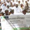 Governor Roba gives sponship cheque to sponsor bushra at pangani high school