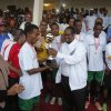 FC captain receving trophy from governor roba in the governor's football tournament